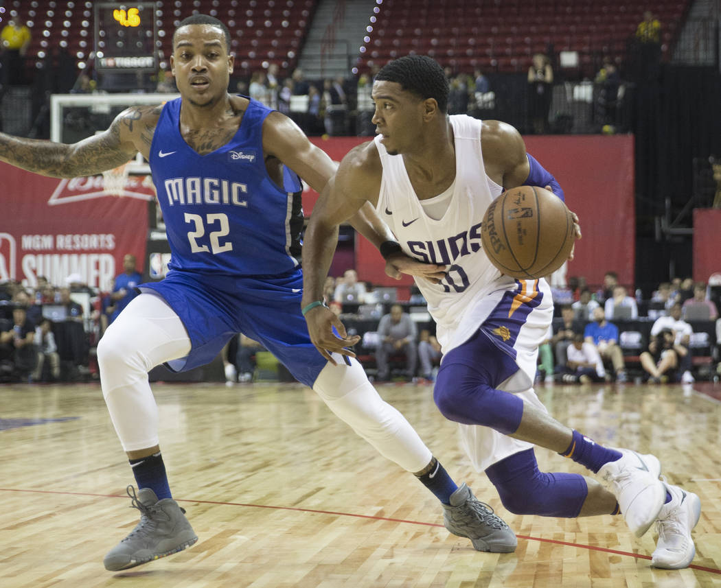 Phoenix Suns guard Shaquille Harrison (10) drives past Orlando Magic guard Troy Caupain (22) in the second quarter during the NBA Summer League on Monday, July 9, 2018, at the Thomas & Mack Ce ...