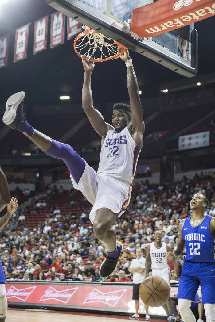 Suns center Deandre Ayton (22) gets a put-back dunk in the third quarter during Phoenix's NBA Summer League game with the Orlando Magic on Monday, July 9, 2018, at the Thomas & Mack Center, i ...
