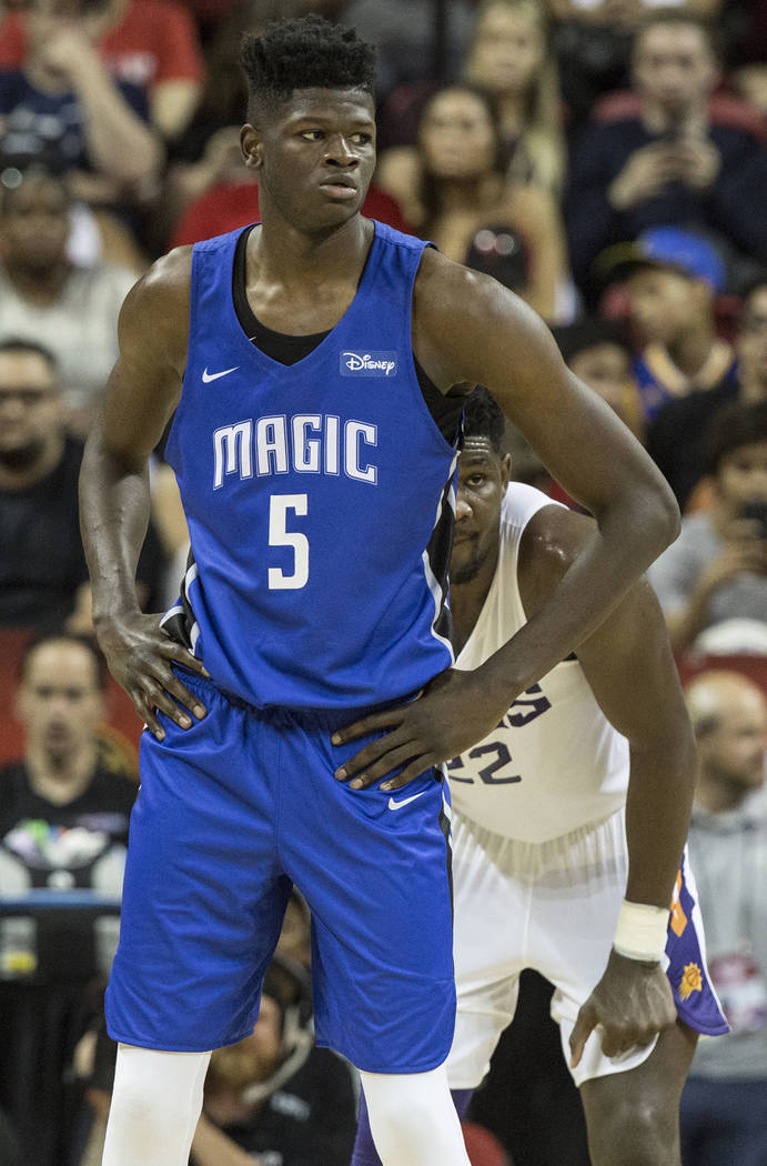 Suns center Deandre Ayton (22) guards Orlando Magic center Mohamed Bamba (5) in the second quarter during the NBA Summer League on Monday, July 9, 2018, at the Thomas & Mack Center, in Las Veg ...