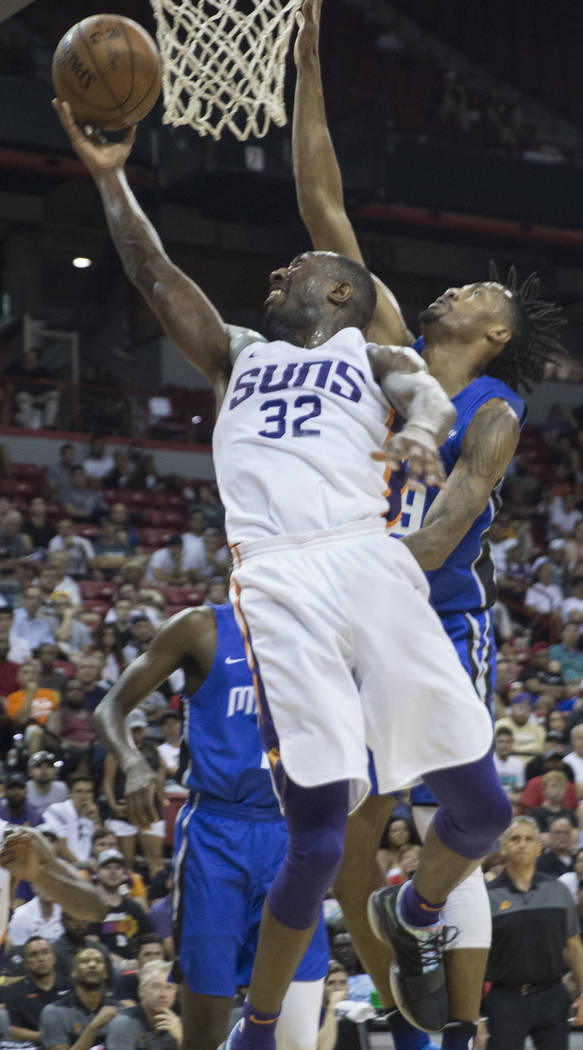 Phoenix Suns guard Davon Reed (32) drives past Orlando Magic guard Braian Angola-Rodas (19) in the second quarter during the NBA Summer League on Monday, July 9, 2018, at the Thomas & Mack Cen ...