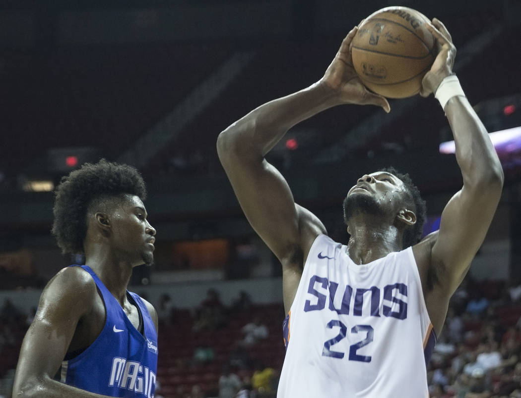 Phoenix Suns center Deandre Ayton (22) drives past Orlando Magic forward Jonathan Isaac (1) in the third quarter during the NBA Summer League on Monday, July 9, 2018, at the Thomas & Mack Cen ...