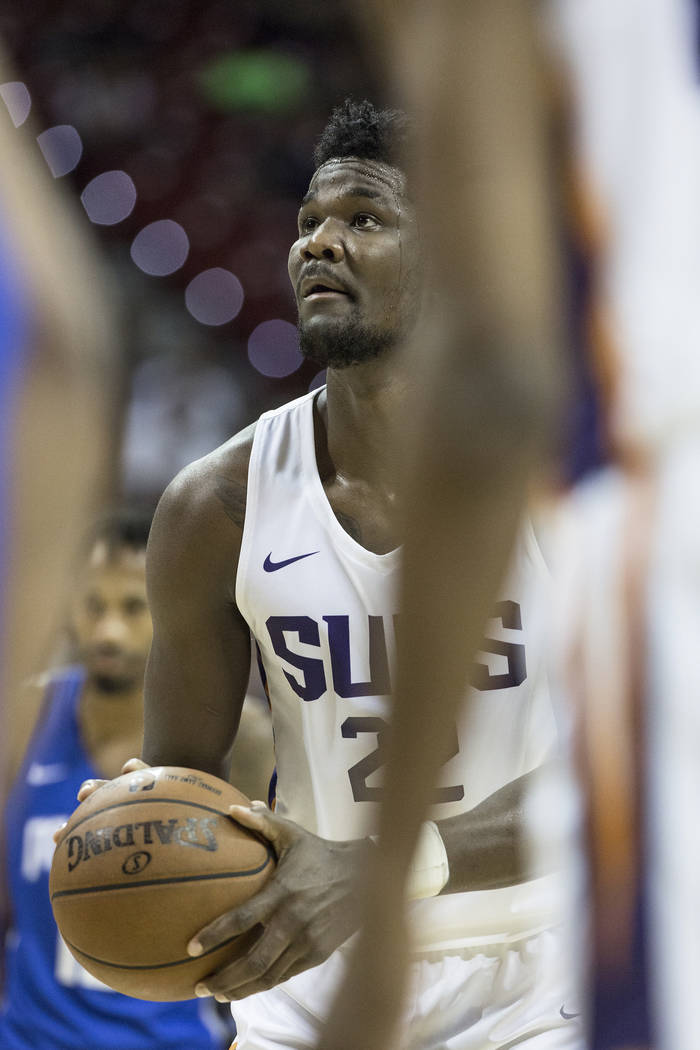 Suns center Deandre Ayton (22) shoots a free throw in the second quarter during Phoenix's NBA Summer League game with the Orlando Magic on Monday, July 9, 2018, at the Thomas & Mack Center, in ...