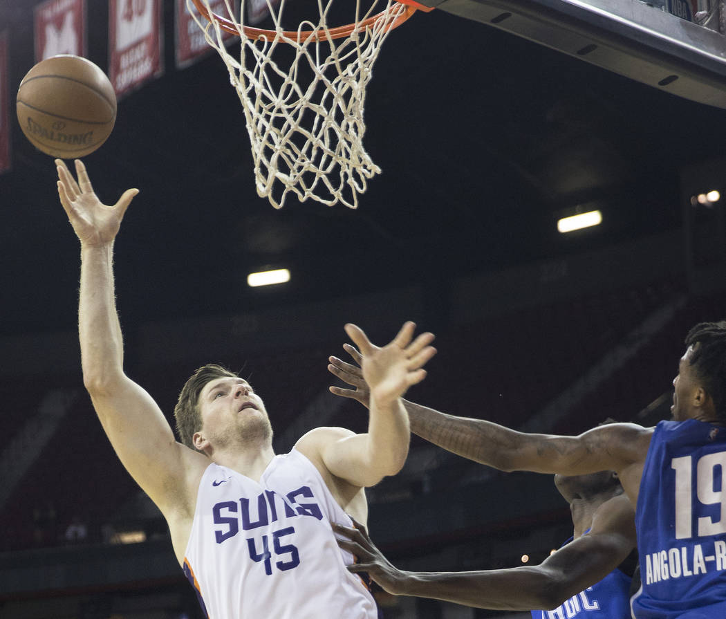 Phoenix Suns center Jack Cooley (45) shoots over Orlando Magic guard Braian Angola-Rodas (19) in the third quarter during the NBA Summer League on Monday, July 9, 2018, at the Thomas & Mack Ce ...