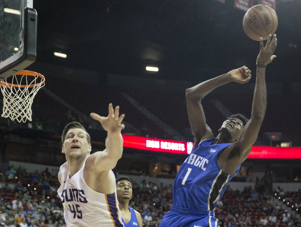 Phoenix Suns center Jack Cooley (45) and Orlando Magic forward Jonathan Isaac (1) reach for a loose ball in the third quarter during the NBA Summer League on Monday, July 9, 2018, at the Thomas &a ...