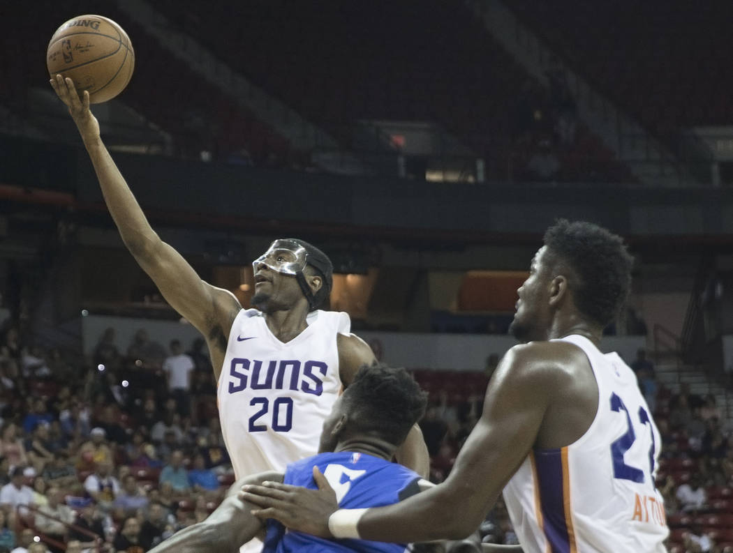 Phoenix Suns forward Josh Jackson (20) drives past Orlando Magic center Mohamed Bamba (5) in the second quarter during the NBA Summer League on Monday, July 9, 2018, at the Thomas & Mack Cente ...