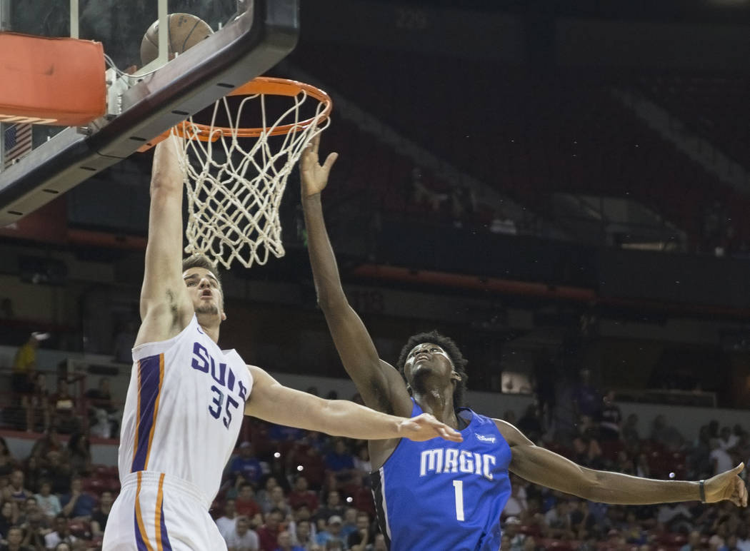 Phoenix Suns forward Dragan Bender (35) drives past Orlando Magic forward Jonathan Isaac (1) in the second quarter during the NBA Summer League on Monday, July 9, 2018, at the Thomas & Mack Ce ...