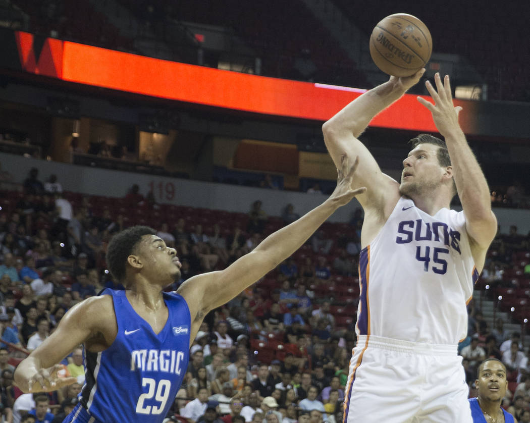 Phoenix Suns center Jack Cooley (45) shoots over Orlando Magic forward Antonio Campbell (29) in the second quarter during the NBA Summer League on Monday, July 9, 2018, at the Thomas & Mack Ce ...