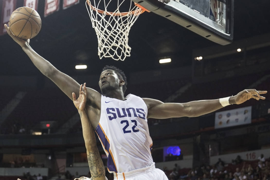Phoenix Suns center Deandre Ayton (22) grabs a rebound over Orlando Magic guard Jay Wright (3) in the third quarter during the NBA Summer League on Monday, July 9, 2018, at the Thomas & Mack C ...