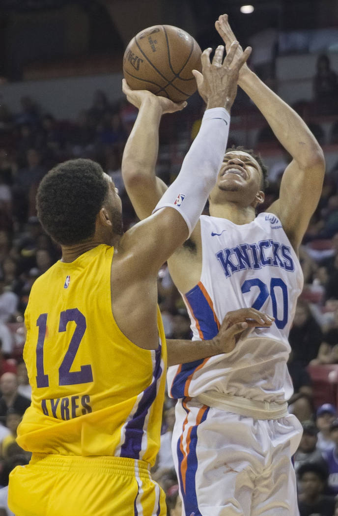 New York Knicks forward Kevin Knox (20) shoots over Los Angeles Lakers forward Jeff Ayres (12) in the fourth quarter during the NBA Summer League on Tuesday, July 10, 2018, at the Thomas & Mac ...