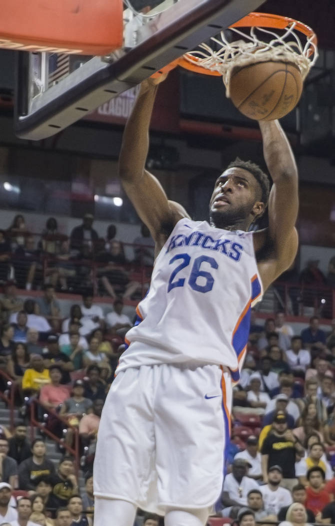 Knicks center Mitchell Robinson (26) gets a put-back dunk in the first quarter during New York's NBA Summer League game with the Los Angeles Lakers on Tuesday, July 10, 2018, at the Thomas & M ...