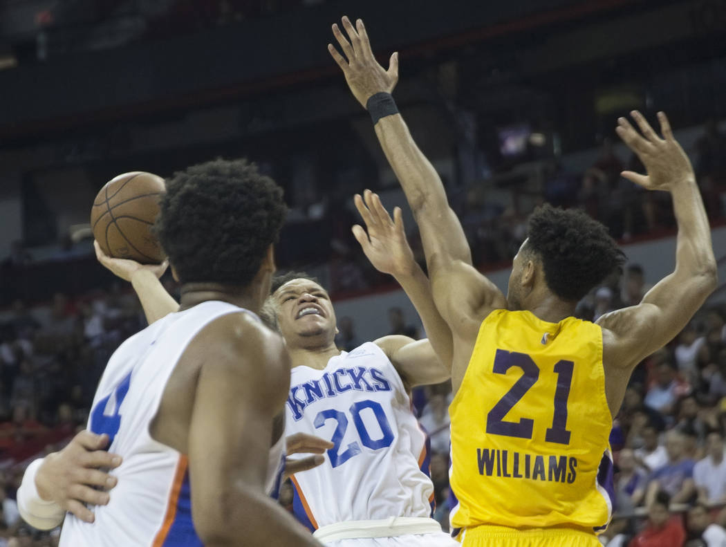 New York Knicks forward Kevin Knox (20) shoots over Los Angeles Lakers forward Johnathan Williams (21) in the fourth quarter during the NBA Summer League on Tuesday, July 10, 2018, at the Thomas & ...
