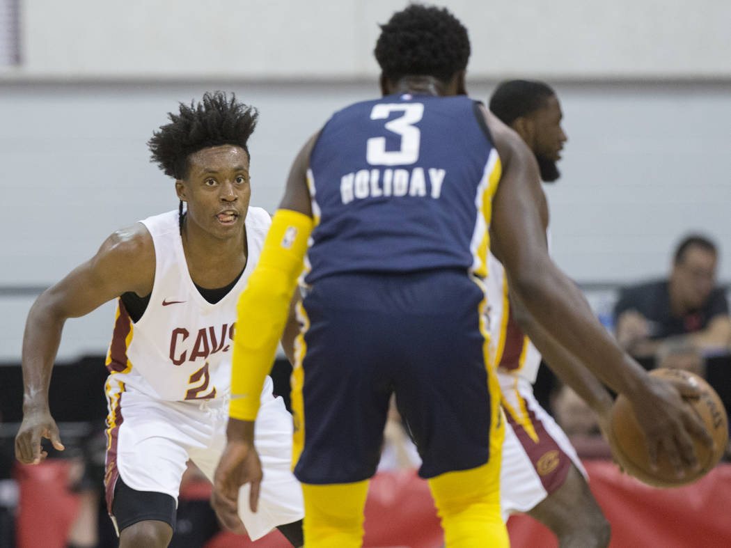 Cleveland Cavaliers guard Collin Sexton (2) defends Indiana Pacers guard Aaron Holiday (3) in the first quarter during the NBA Summer League on Monday, July 9, 2018, at Cox Pavilion, in Las Vegas. ...