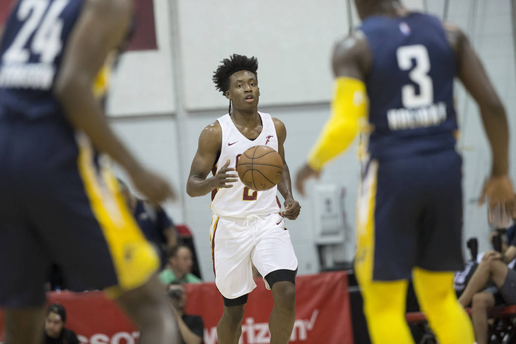 Cleveland Cavaliers guard Collin Sexton (2) brings the ball up court against Indiana Pacers guard Aaron Holiday (3) and forward Alize Johnson (24) in the first quarter during the NBA Summer League ...