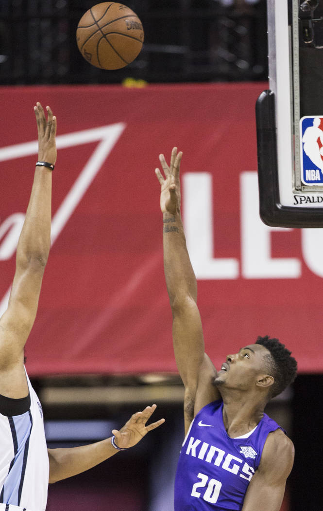 Sacramento Kings forward Harry Giles (20) reaches out to block the shot of Memphis Grizzlies guard Jevon Carter (3) in the second quarter during the NBA Summer League on Tuesday, July 10, 2018, at ...
