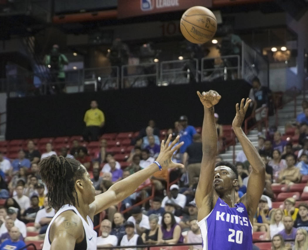 Sacramento Kings forward Harry Giles (20) shoots a corner jump shot over a Memphis Grizzlies defender in the second quarter during the NBA Summer League on Tuesday, July 10, 2018, at the Thomas &a ...