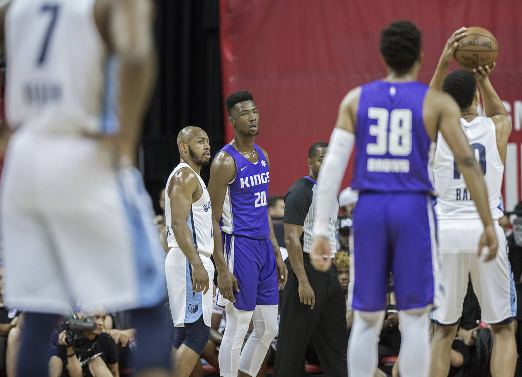 Sacramento Kings forward Harry Giles (20) watches as Memphis Grizzlies forward Ivan Rabb (10) shoots a free throw in the first quarter during the NBA Summer League on Tuesday, July 10, 2018, at th ...