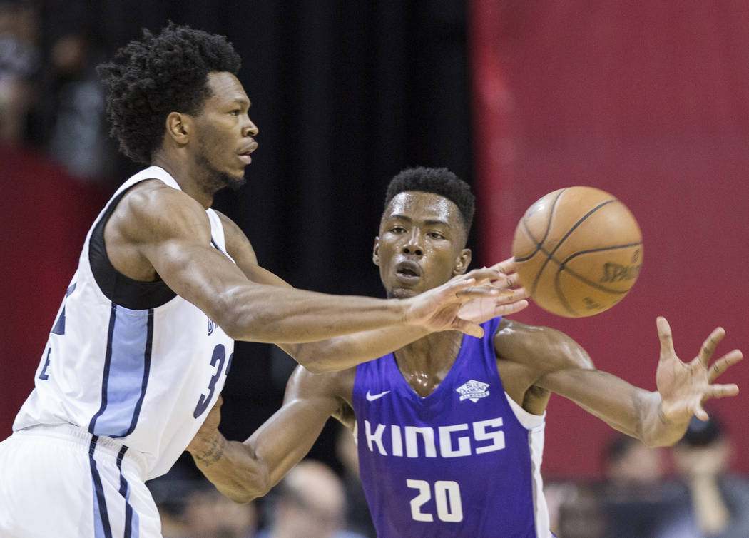 Sacramento Kings forward Harry Giles (20) defends Memphis Grizzlies forward William Lee (32) in the first quarter during the NBA Summer League on Tuesday, July 10, 2018, at the Thomas & Mack C ...