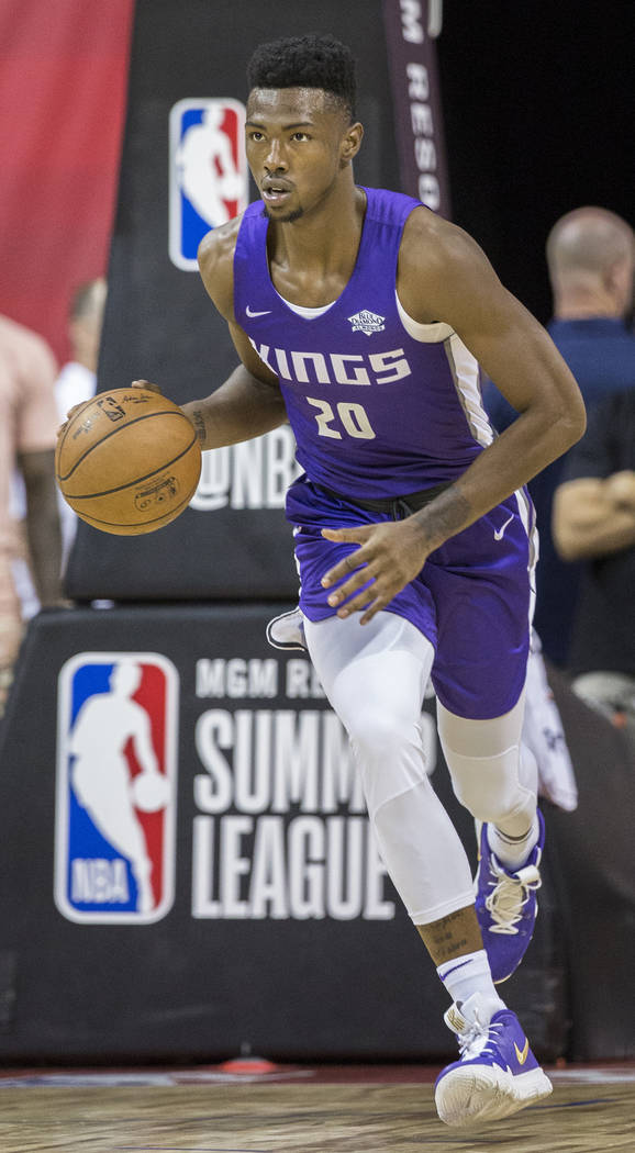 Kings forward Harry Giles (20) pushes the ball up court during the first quarter of Sacramento's NBA Summer League game with the Memphis Grizzlies on Tuesday, July 10, 2018, at the Thomas & Ma ...