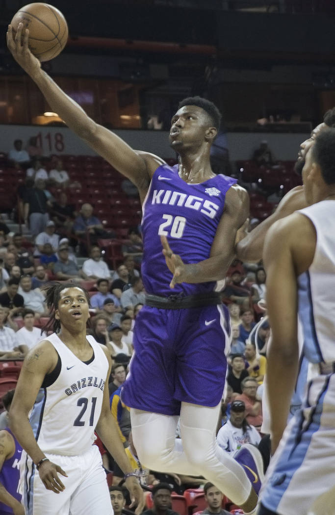 Sacramento Kings forward Harry Giles (20) slashes to the rim past past Grizzlies defenders in the 1st quarter during the NBA Summer League on Tuesday, July 10, 2018, at the Thomas & Mack Cente ...