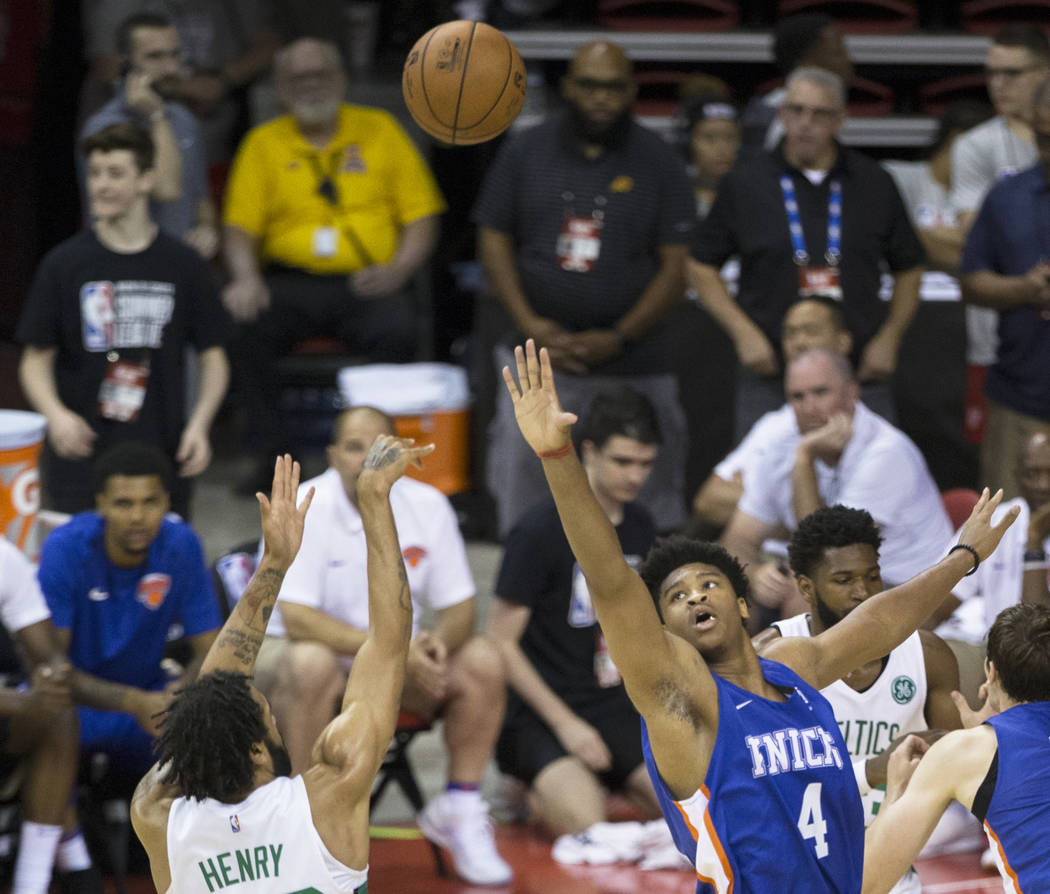 New York Knicks forward Isiah Hicks (4) reaches to block the shot of Boston Celtics guard Pierria Henry (49) in the third quarter during the NBA Summer League on Thursday, July 12, 2018, at the Th ...