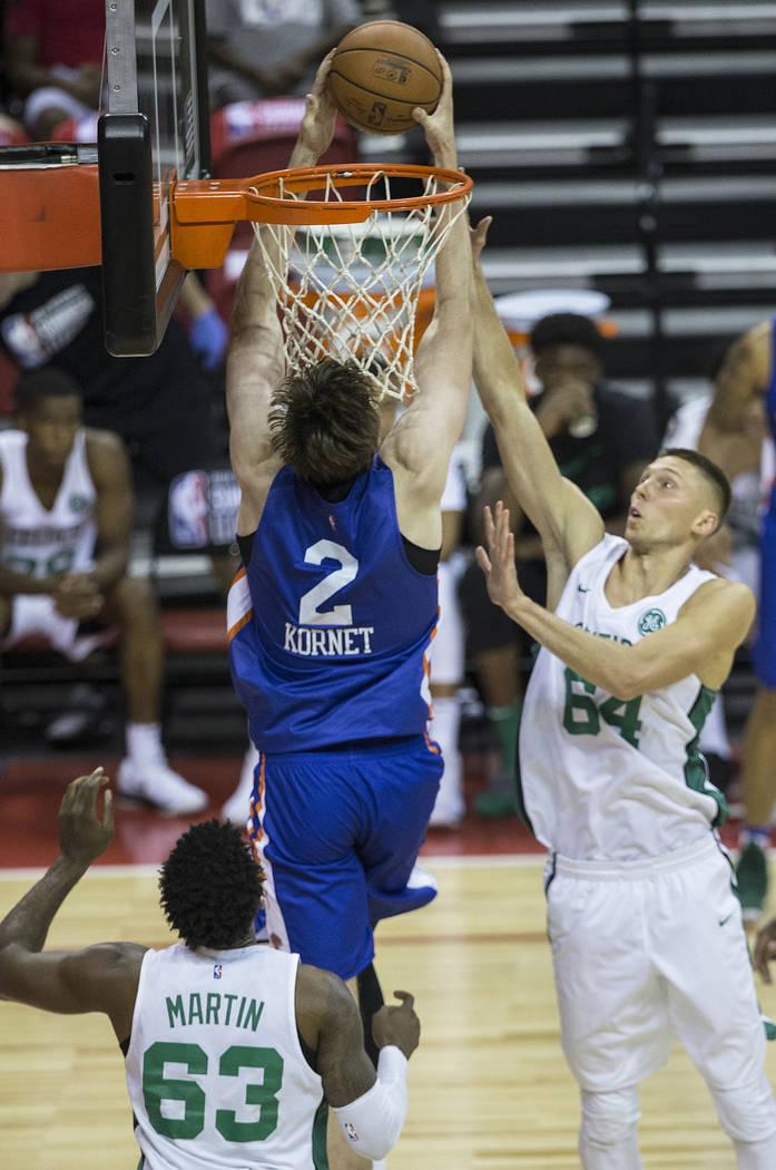 New York Knicks guard Luke Kornet (2) reverse dunks on Boston Celtics forward Jarrod Uthoff (64) in the third quarter during the NBA Summer League on Thursday, July 12, 2018, at the Thomas & M ...