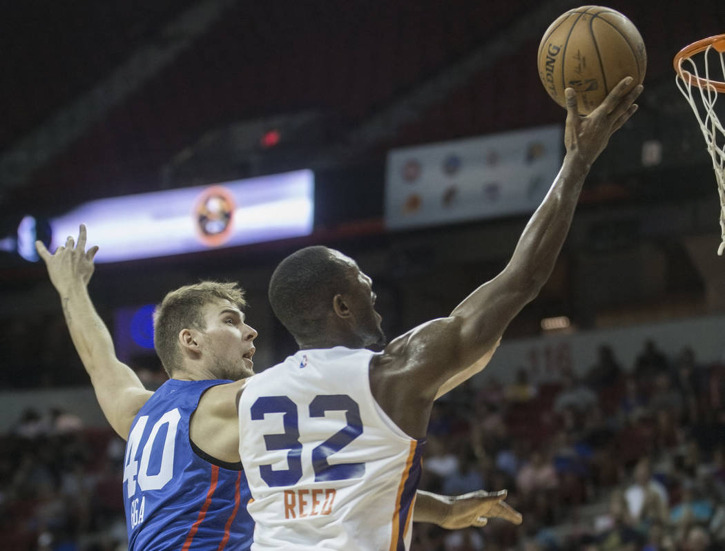 Phoenix Suns guard Davon Reed (32) drives past Philadelphia 76ers forward Norbertas Giga (40) in the first quarter during the NBA Summer League on Thursday, July 12, 2018, at the Thomas & Mack ...