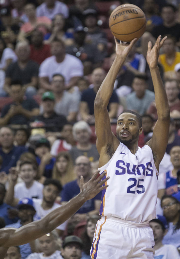 Phoenix Suns forward Mikal Bridges (25) shoots a corner jump shot in the second quarter during Phoenix's NBA Summer League game with the Philadelphia 76ers on Thursday, July 12, 2018, at the Thoma ...