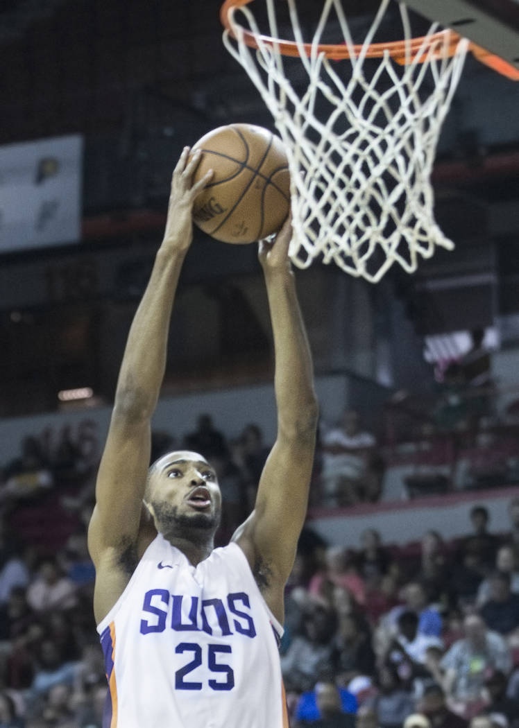 Phoenix Suns forward Mikal Bridges (25) converts a fast break dunk in the second quarter during Phoenix's NBA Summer League game with the Philadelphia 76ers on Thursday, July 12, 2018, at the Thom ...