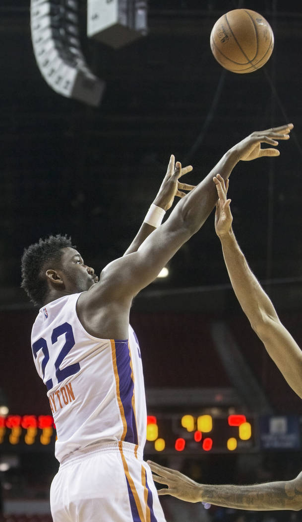 Suns center Deandre Ayton (22) shoots a corner jump shot in the second quarter during Phoenix's NBA Summer League game with the Philadelphia 76ers on Thursday, July 12, 2018, at the Thomas & M ...
