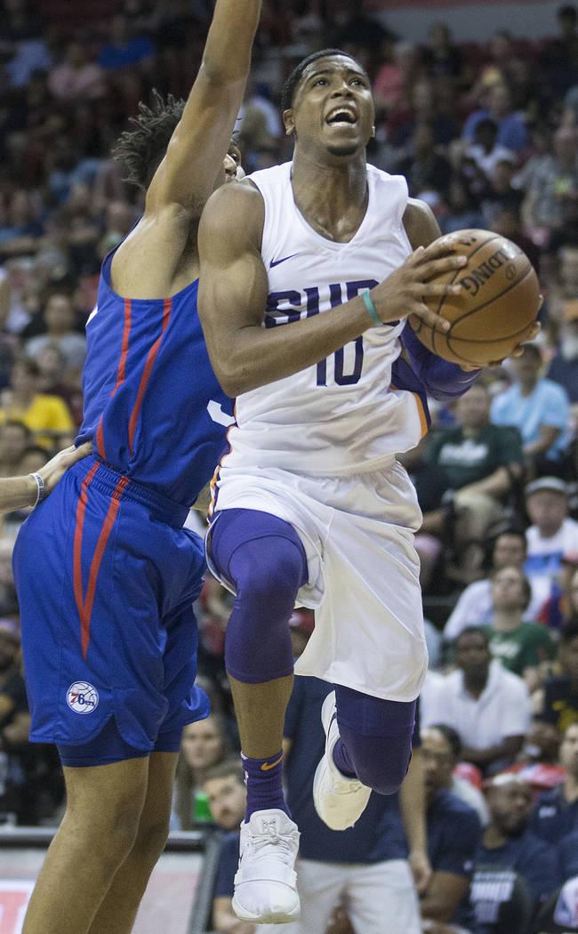 e23e08b99 Phoenix Suns guard Shaquille Harrison (10) drives past Philadelphia 76ers  center Norvel Pelle (