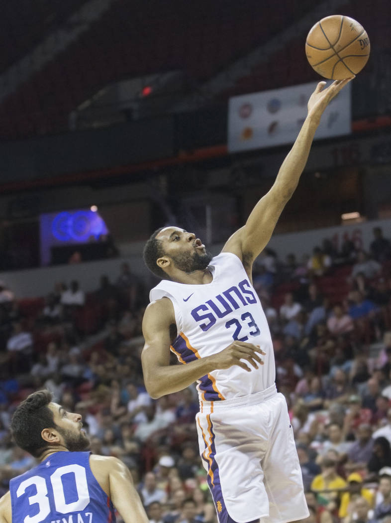Phoenix Suns forward Rahlir Hollis-Jefferson (23) drives past Philadelphia 76ers guard Furkan Korkmaz (30) in the second quarter during the NBA Summer League on Thursday, July 12, 2018, at the Tho ...