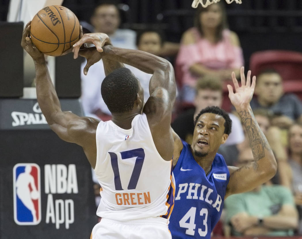 Philadelphia 76ers forward Chris McCullough (43) defends Phoenix Suns guard Javonte Green (17) in the third quarter during the NBA Summer League on Thursday, July 12, 2018, at the Thomas & Mac ...