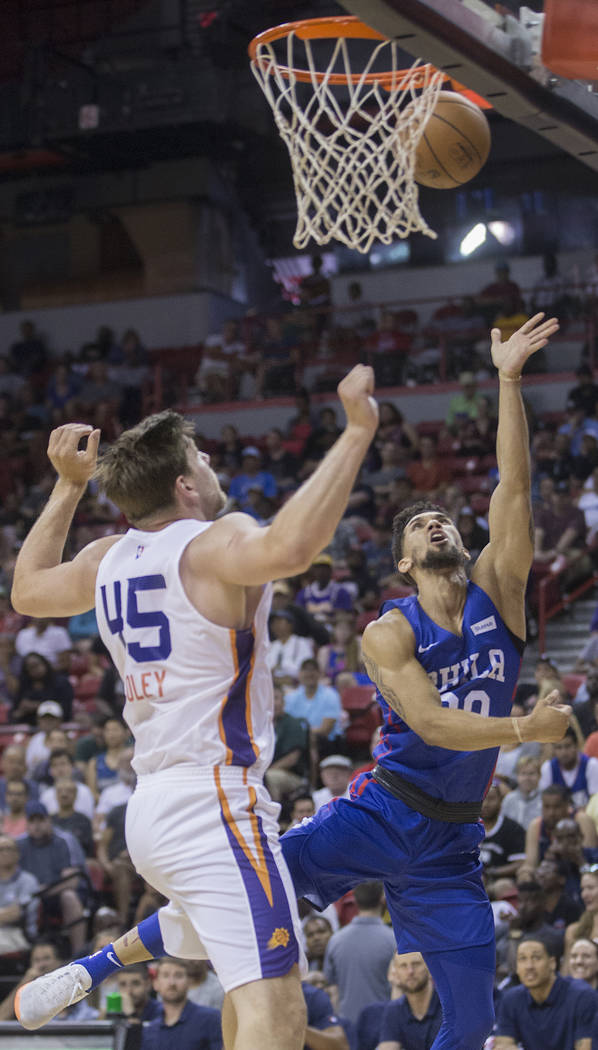 Philadelphia 76ers guard Askia Booker (00) drives past Phoenix Suns center Jack Cooley (45) in the third quarter during the NBA Summer League on Thursday, July 12, 2018, at the Thomas & Mack ...