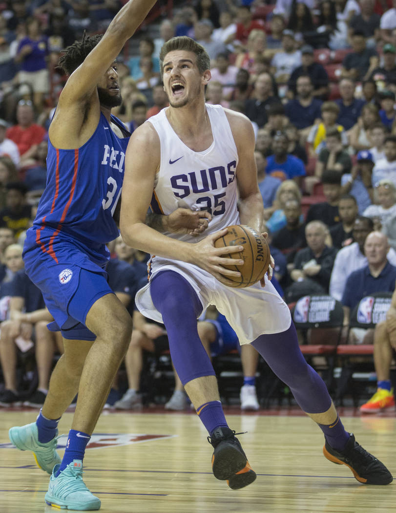 Phoenix Suns forward Dragan Bender (35) drives past Philadelphia 76ers center Norvel Pelle (31) in the second quarter during the NBA Summer League on Thursday, July 12, 2018, at the Thomas & M ...