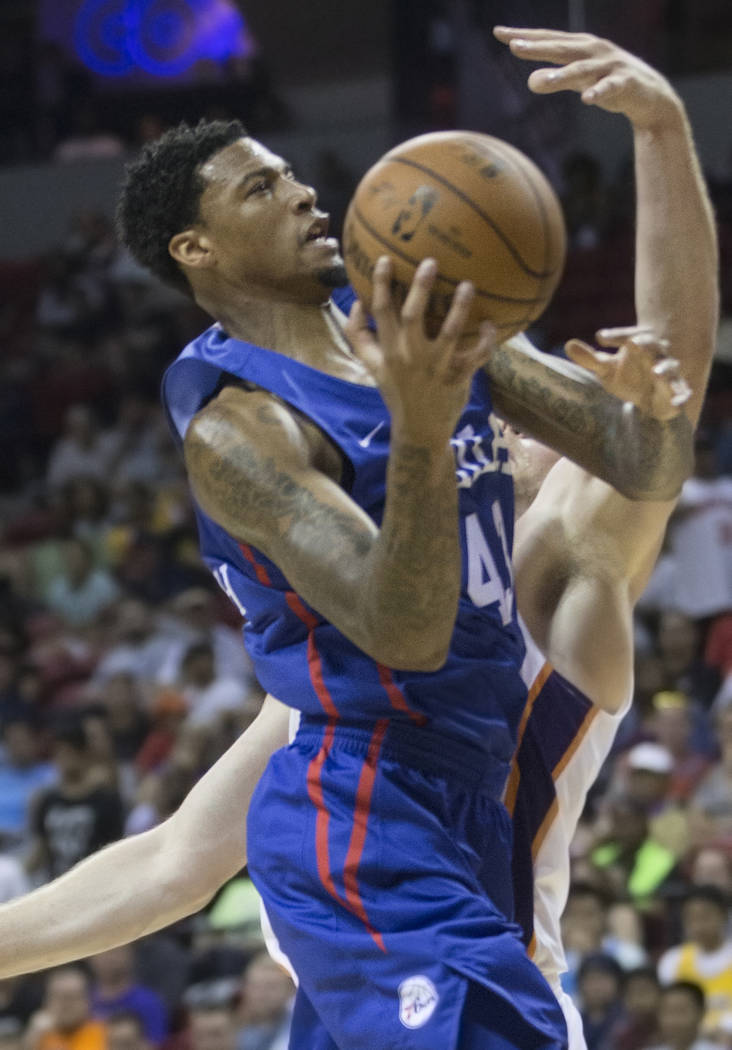 Philadelphia 76ers forward Chris McCullough (43) drives past Phoenix Suns center Jack Cooley (45) in the third quarter during the NBA Summer League on Thursday, July 12, 2018, at the Thomas & ...