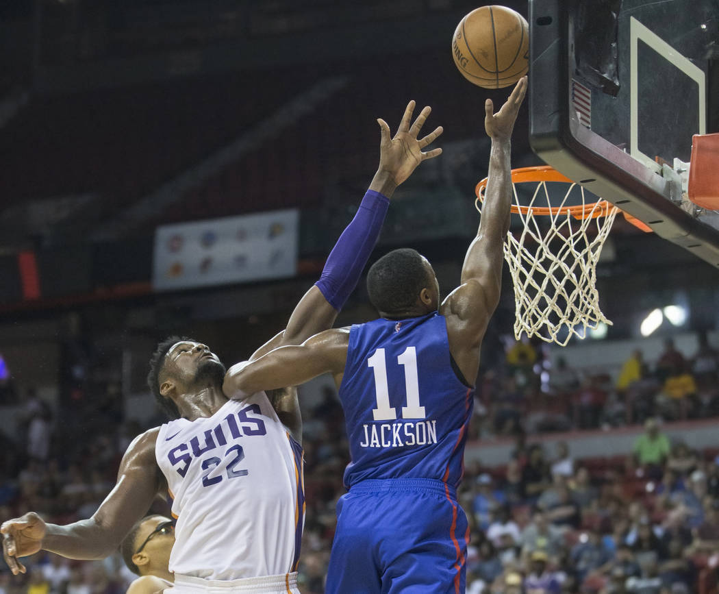 Phoenix Suns center Deandre Ayton (22) reaches to block the shot of Philadelphia 76ers guard Demetrius Jackson (11) in the third quarter during the NBA Summer League on Thursday, July 12, 2018, at ...