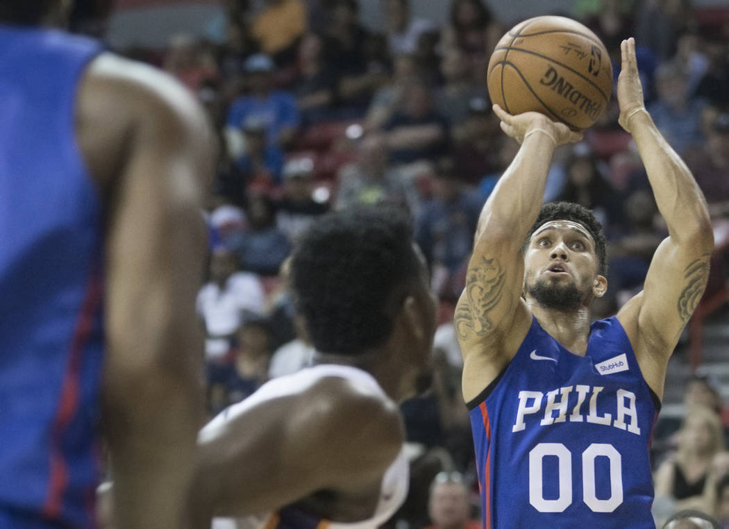 Philadelphia 76ers guard Askia Booker (00) shoots a corner jump shot over Phoenix Suns center Deandre Ayton (22) in the third quarter during the NBA Summer League on Thursday, July 12, 2018, at th ...