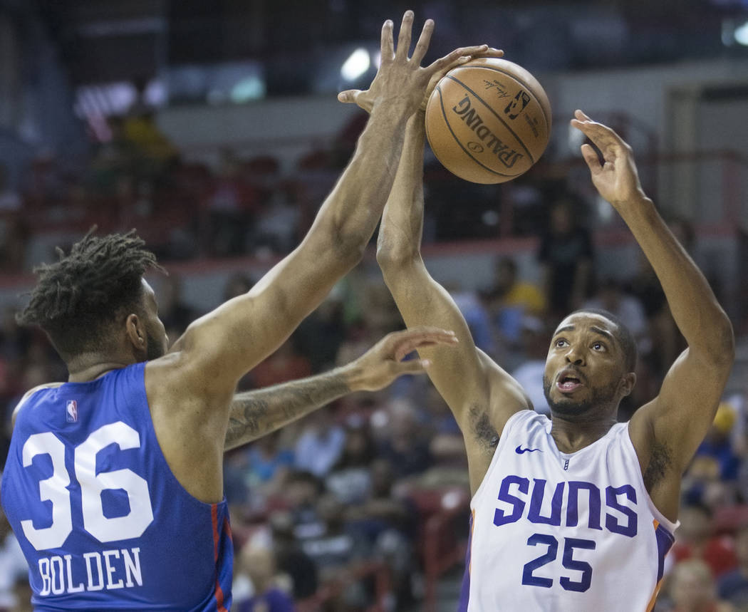 Phoenix Suns forward Mikal Bridges (25) drives past Philadelphia 76ers forward Jonah Bolden (36) in the second quarter during the NBA Summer League on Thursday, July 12, 2018, at the Thomas & ...