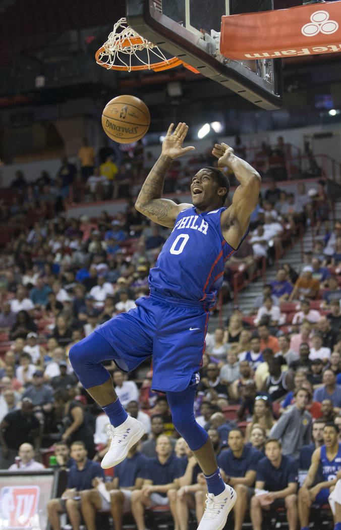 76ers forward Cameron Oliver (0) converts a fast break dunk in the third quarter during Philadelphia's NBA Summer League game with the Phoenix Suns on Thursday, July 12, 2018, at the Thomas & ...