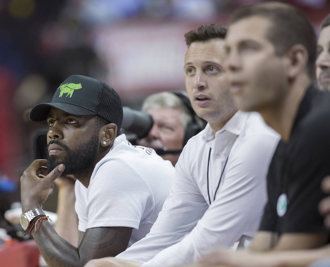 Celtics star point guard Kyrie Irving, left, watches Boston play the New York Knicks during the NBA Summer League on Thursday, July 12, 2018, at the Thomas & Mack Center, in Las Vegas. Benjami ...