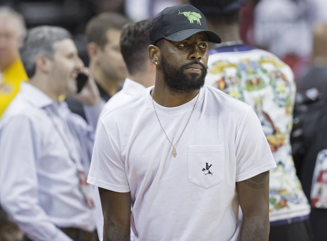 Celtics star point guard Kyrie Irving watches Boston play the New York Knicks during the NBA Summer League on Thursday, July 12, 2018, at the Thomas & Mack Center, in Las Vegas. Benjamin Hager ...