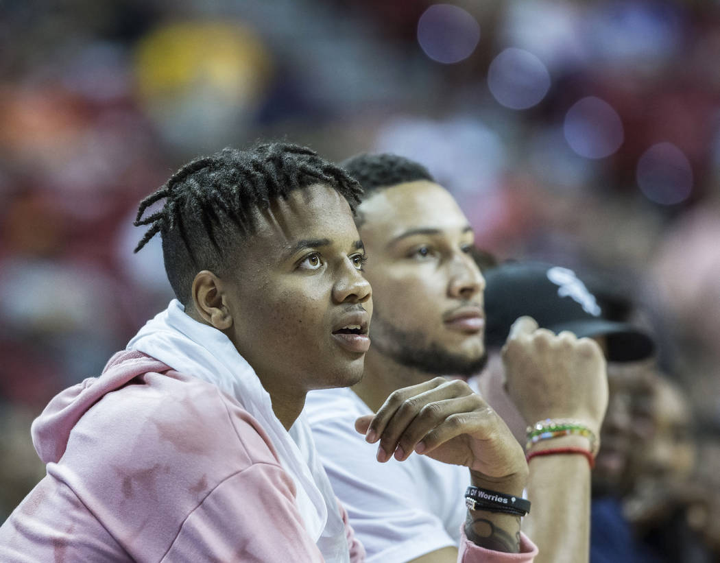 76ers point guards Markelle Fultz, left, and Ben Simmons watch Philadelphia's NBA Summer League game with the Phoenix Suns on Thursday, July 12, 2018, at the Thomas & Mack Center, in Las Vegas ...