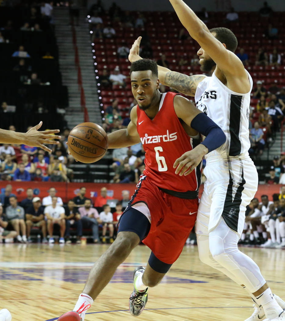 Washington Wizards' guard Troy Brown (6) drives past the San Antonio Spurs' guard Trey Mckinney-Jones (17) during an NBA Summer League basketball game at the Thomas and Mack Center on Sunday, July ...