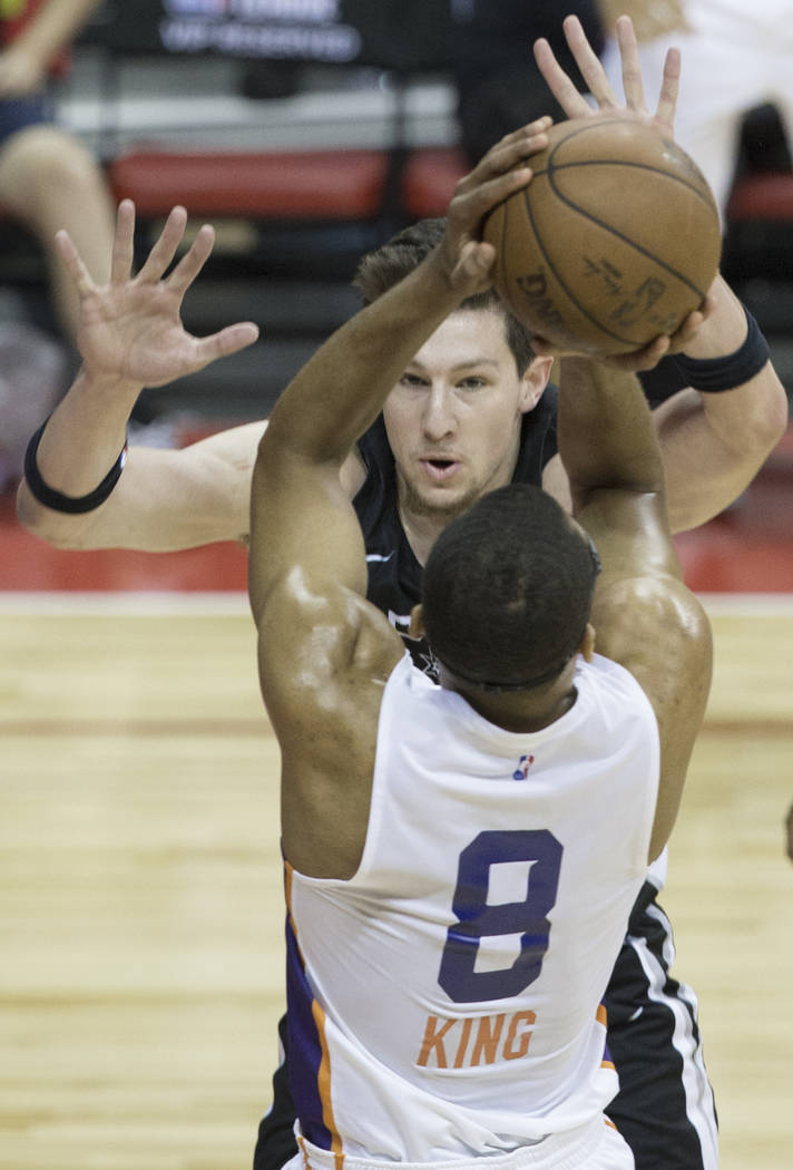 Phoenix Suns forward George King (8) shoots over San Antonio Spurs center Drew Ebanks (25) in the first quarter during the NBA Summer League on Friday, July 13, 2018, at the Thomas & ...