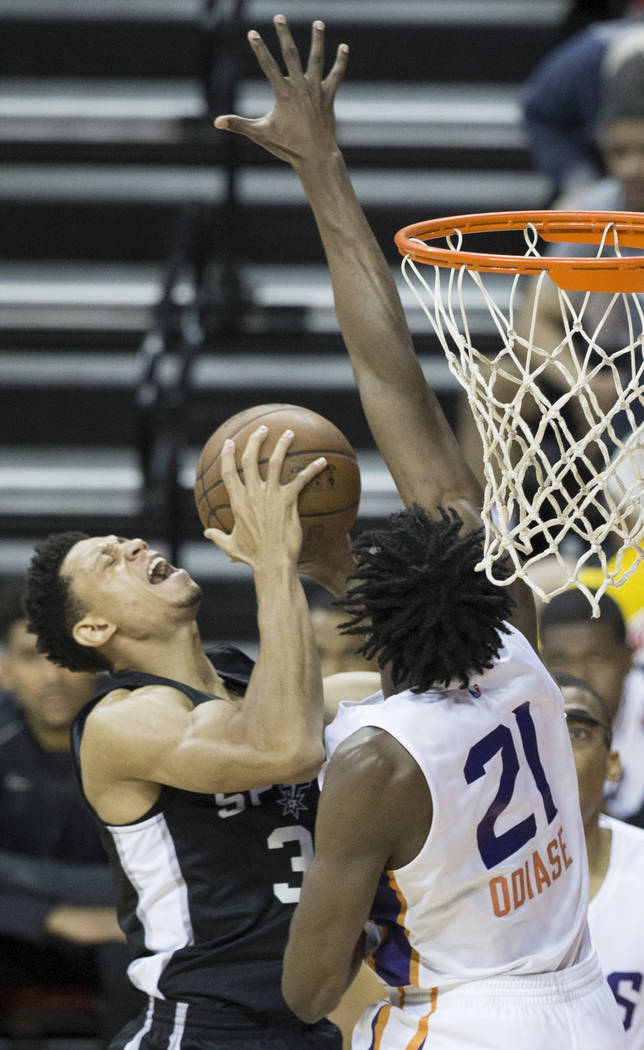 San Antonio Spurs guard Jordan Green (30) collides with Phoenix Suns forward Tai Odiase (21) in the fourth quarter during the NBA Summer League on Friday, July 13, 2018, at the Thomas &a ...
