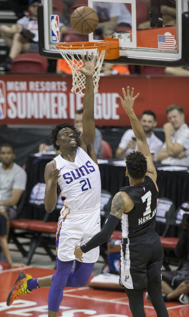 Phoenix Suns forward Tai Odiase (21) leaps to block the shot of San Antonio Spurs forward Oliver Hanlan (7) in the third quarter during the NBA Summer League on Friday, July 13, 2018, at ...