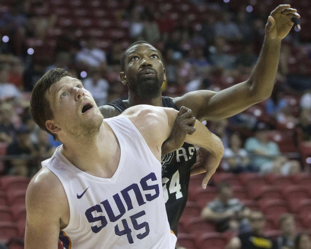 Phoenix Suns center Jack Cooley (45) fights for a rebound with San Antonio Spurs forward Cory Jefferson (34) in the second quarter during the NBA Summer League on Friday, July 13, 2018, ...