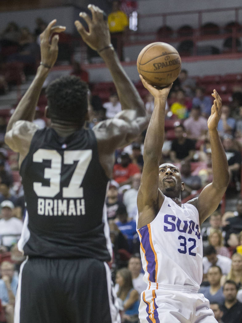 Phoenix Suns guard Devon Reed (32) drives past San Antonio Spurs center Amida Brimah (37) in the second quarter during the NBA Summer League on Friday, July 13, 2018, at the Thomas & ...