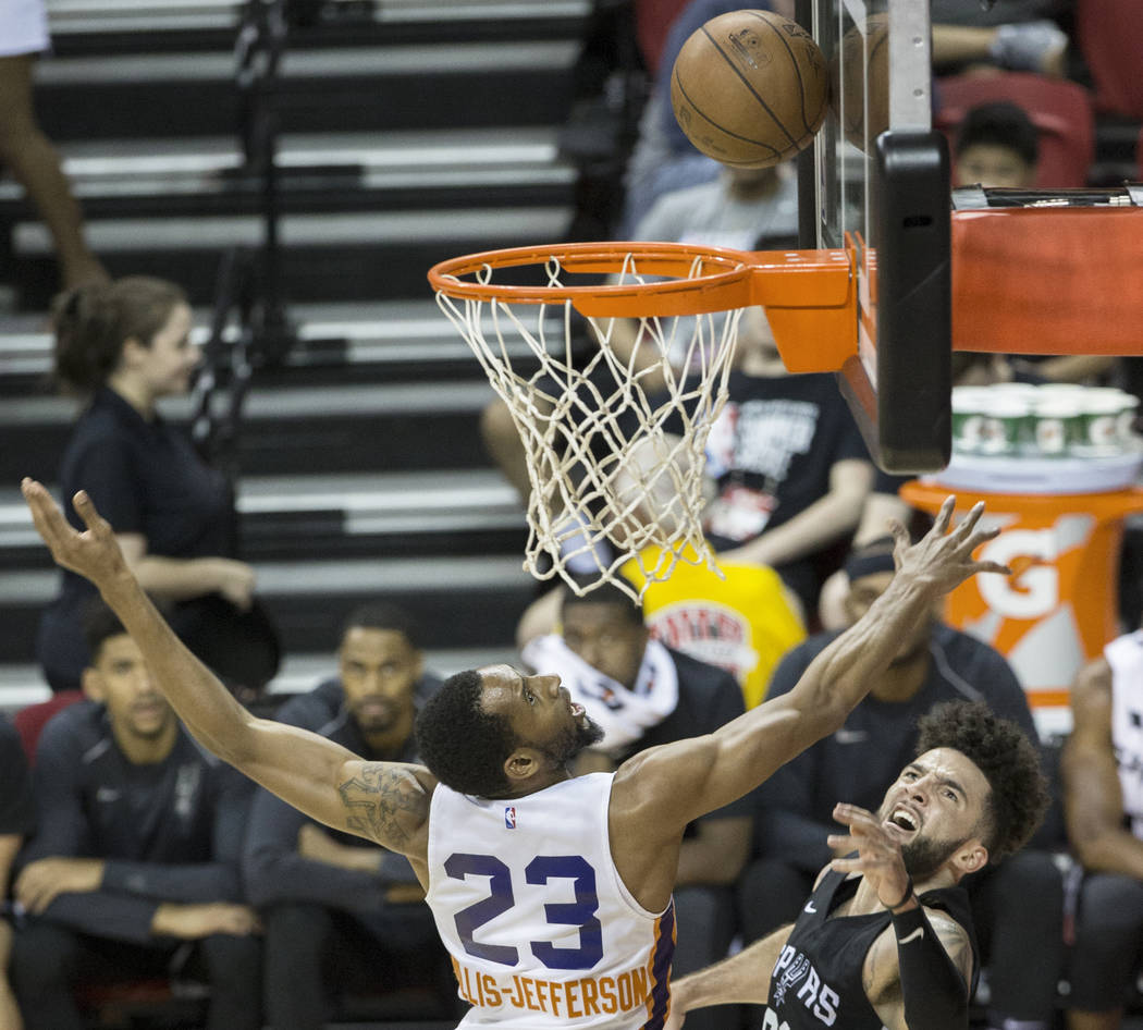 Phoenix Suns forward Rahlir Hollis-Jefferson (23) leaps to block the shot of San Antonio Spurs guard London Perrantes (83) in the fourth quarter during the NBA Summer League on Friday, J ...