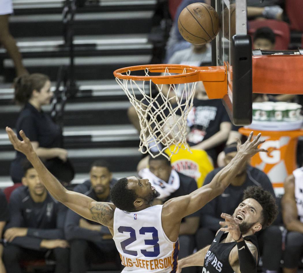 Phoenix Suns forward Rahlir Hollis-Jefferson (23) leaps to block the shot of San Antonio Spurs guard London Perrantes (83) in the fourth quarter during theNBA Summer Leagueon Friday, J ...